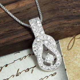 天然ダイヤモンド0.1ctラッキーホースシューペンダント ホ...